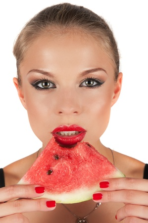 beautiful young woman eat juicy watermelon over white photo