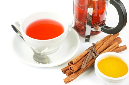 Cup of hot berries tea with cinnamon sticks, and honey Stock Photo - 16066103