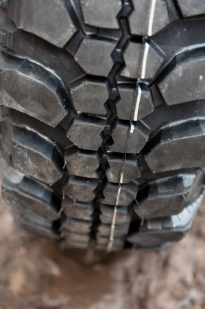 Close up of a car tire on a dirty road  photo