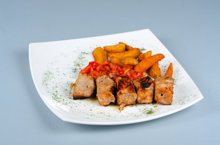 Grilled kebab pork meat with roasted potato and vegetables Stock Photo - 16262661