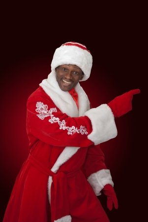 surprised black santa claus on a color background photo