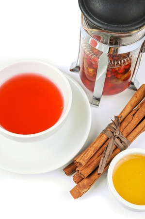Cup of black tea from cowberry and mint with cinnamon sticks, and honey Stock Photo - 16456424
