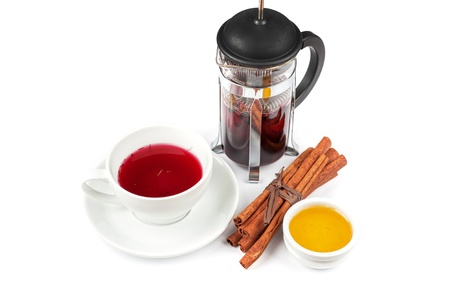 Cup of tea from blueberry and chabrets with cinnamon sticks, and honey photo