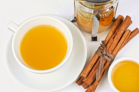 Cup of hot linden tea with cinnamon sticks, and honey Stock Photo - 16553986