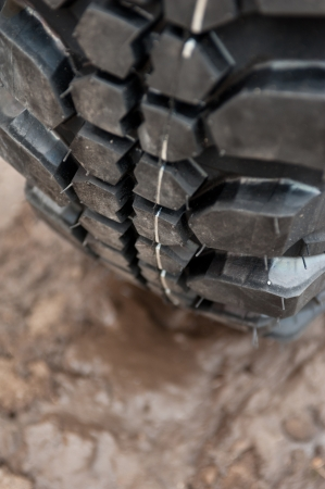 Close up of a car tire on a dirty road. photo