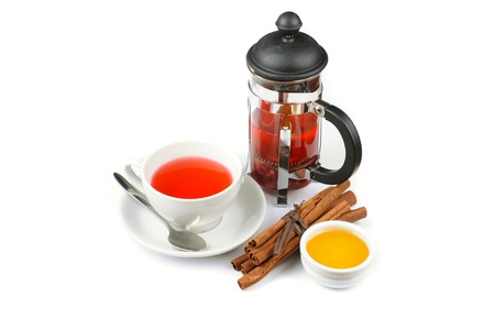 Cup of black tea from cowberry and mint with cinnamon sticks, and honey Stock Photo - 16580501