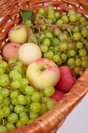 apples and grapes in a basket just harvest photo