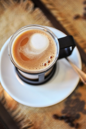 crema: Cup of cappuccino on a table