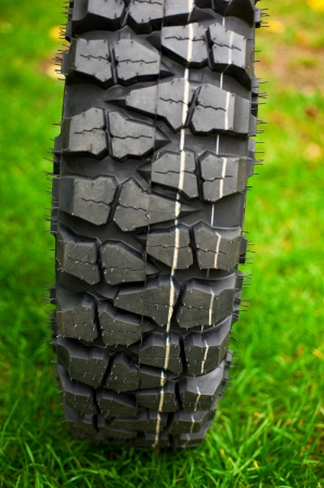Tire at green grass background photo