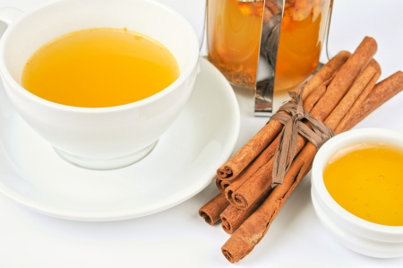 Cup of hot linden tea with cinnamon sticks, and honey Stock Photo - 17767596