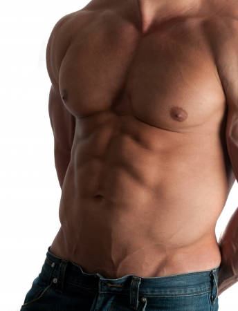 male arm: Muscular male torso of bodybuilder at jeans on white background
