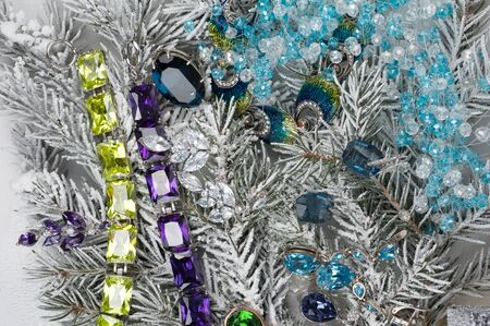 Jewelry with gems at fir tree photo