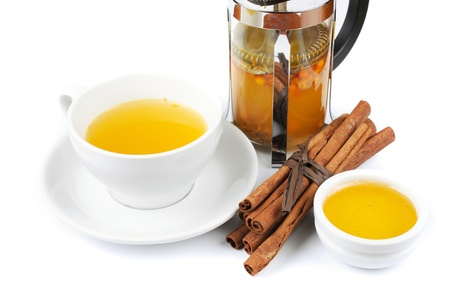 Cup of hot linden tea with cinnamon sticks, and honey Stock Photo - 17767769