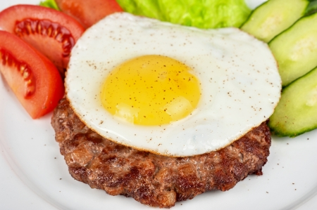homestyle: steak beef meat with fried egg, tomato, cucumbers and salad