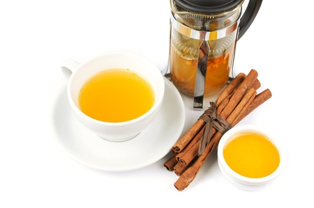 Cup of hot linden tea with cinnamon sticks, and honey photo