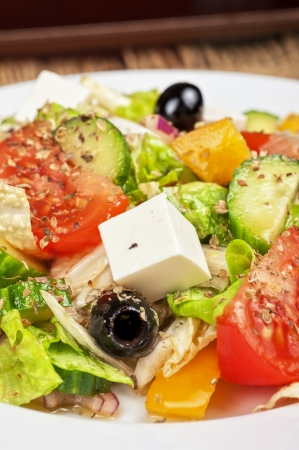 Greek salad  feta cheese, olive and vegetables  photo