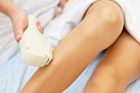 Laser hair removal on ladies legs Stock Photo - 18844146