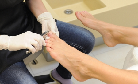 young girl feet: Professional pedicure at the spa