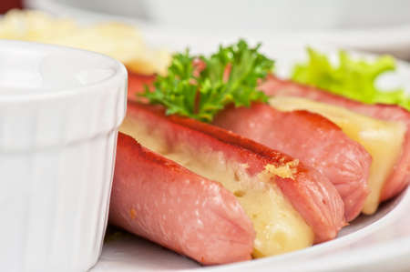Appetizer - sausages with cheese and sauce photo