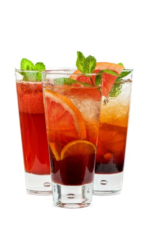 Set of fresh cold tea with fruits, berries and ice on white photo