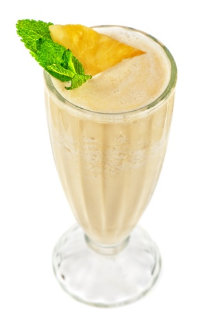 pineapple milk cocktail on a white photo