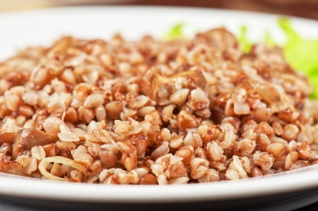 Russian traditional buckwheat with mushrooms and onion photo