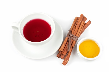 Cup of hot berries tea with cinnamon sticks, and honey Stock Photo - 20072909