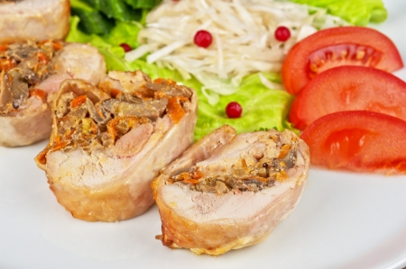 champignons: Chicken rolls with champignons and vegetables Stock Photo