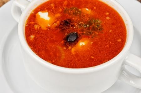 solyanka: Closeup of solyanka soup at plate Stock Photo