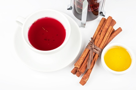Cup of hot berries tea with cinnamon sticks, and honey Stock Photo - 21444311