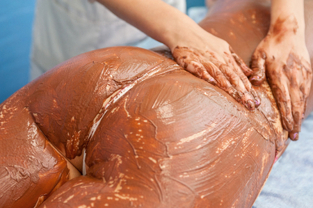 chocolate mask: Spa therapy for woman receiving cosmetic chocolate mask