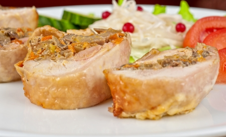 Chicken rolls with champignons and vegetables photo