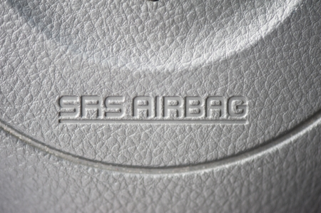 close up of airbag steering wheel symbol photo