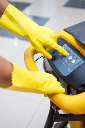 Cleaner workers with mop in uniform cleaning floor Standard-Bild