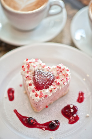 tasty heart-shaped valentine cake photo