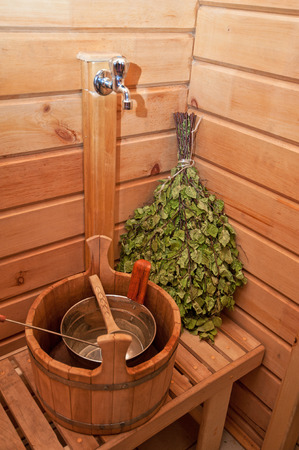 traditional sauna stuff -  birch whisk and a bucket photo