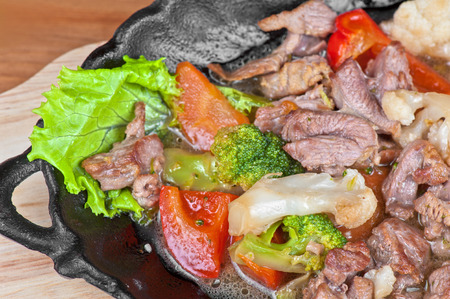 meat with vegetables at frying pan photo