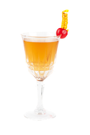 cognac cocktail with cherry on white photo