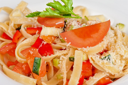 Penne pasta with parmesan cheese, herbs, tomatoes and basil photo