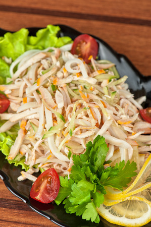 Salad with calamary and fresh vegetable photo