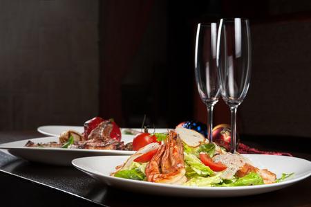 buffet table: Tasty shrimp salad with vegetables on christmas table