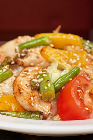 Warm salad with chicken, vegetable and sesame seeds photo