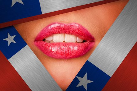 Beautiful female lips closeup behind chile background photo