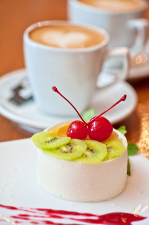 tasty fruit dessert with cherry and kiwi with coffee photo