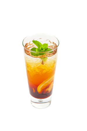 cold tea with ripe ginger, lemon, mint and ice on white photo