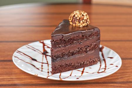 tasty piece of chocolate cake closeup photo