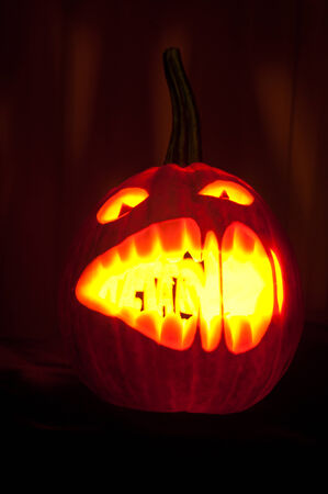 black backgound: Halloween pumpkin with scary face on black backgound Stock Photo