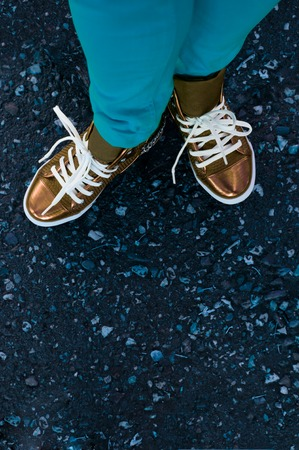 sneakers closeup stand on road photo