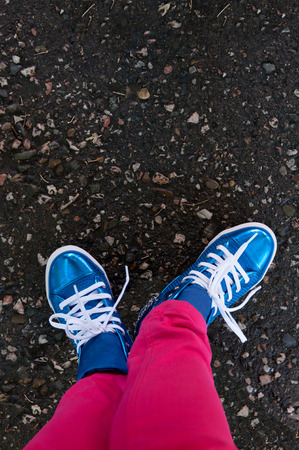 lacing sneakers: sneakers closeup stand on road Stock Photo