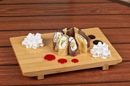 pancake roll with marmalade - dessert dish photo